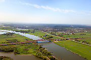 Nederland, Gelderland - Overijssel, Hattem, 01-05-2013; IJsselbrug, spoorbrug bij Hattem voor de Hanzelijn. Hattem in de achtergrond.<br /> De 'Hanzeboog' is ontworpen door  Quist Wintermans Architecten.<br /> The red railway bridge Hanzeboog (Hanseatic arch) over the IJssel near Zwolle, has been designed by Quist Wintermans Architects. <br /> luchtfoto (toeslag op standard tarieven);<br /> aerial photo (additional fee required);<br /> copyright foto/photo Siebe Swart