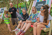People take advantage of the deck chairs and sofas in the BBC Music area in the woods - The 2017 Latitude Festival, Henham Park. Suffolk 15 July 2017