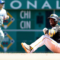 Pittsburgh Pirates center fielder Andrew McCutchen (22) reacts after he slides pass second base and is out by Los Angeles Dodgers left fielder Howie Kendrick appling the tag  in the seventh inning  at PNC Park on June 27, 2016 in Pittsburgh.  Photo by Archie Carpenter/UPI