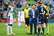 Melbourne Victory midfielder Keisuke Honda (4) and Perth Glory forward Andy Keogh (9) coin toss at the Hyundai A-League Round 2 soccer match between Melbourne Victory and Perth Glory at AAMI Park in Melbourne.