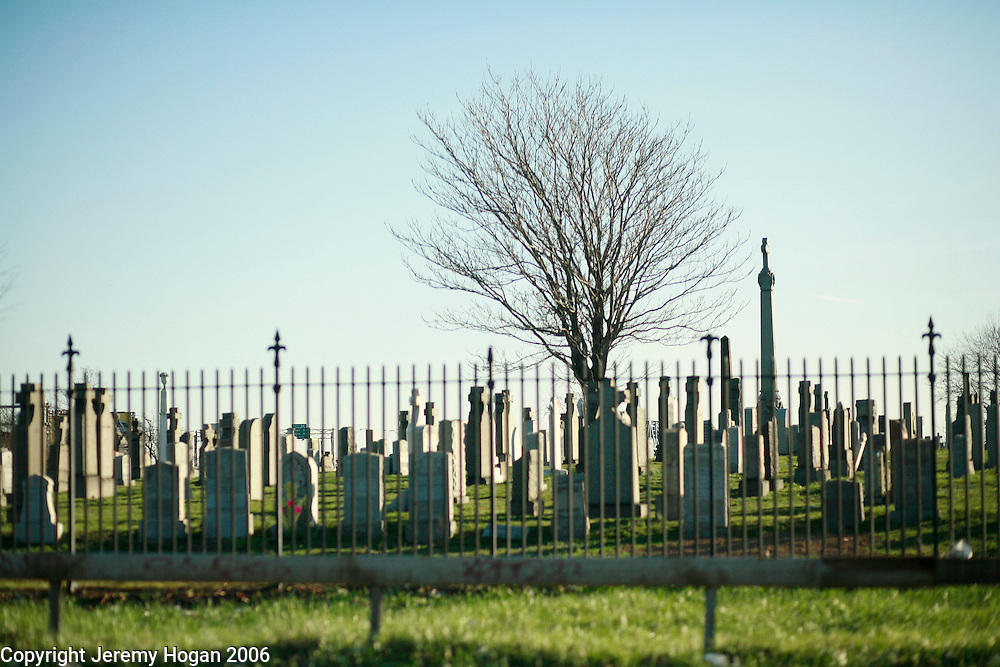A grave yard is passed on a freeway leading from Queens to Manhattan. ..