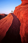 Mother and child on the sandstone trail to Delicate Arch in Arches National Park, Utah
