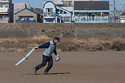 Retired Japanese man, Mr. Nagasuka launching a radio-controlled model glider in a park near Kamoi, Kanagawa, Japan Monday February 20th 2012