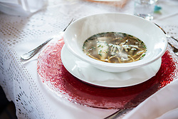 Bow of soup called Hochzeitssuppe on restaurant table, Bavaria, Germany