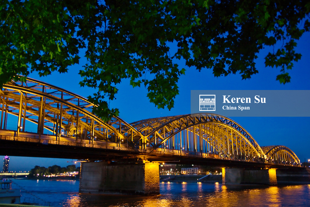 Night view of Hohenzollern Bridge on River Rhine, Cologne, Germany