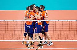 Players of ACH celebrate during volleyball match between ACH Volley Ljubljana and Bre Banca Lannutti Cuneo (ITA) in Playoff 12 game of CEV Champions League 2012/13 on January 15, 2013 in Arena Stozice, Ljubljana, Slovenia. (Photo By Vid Ponikvar / Sportida.com)
