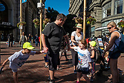 Image of a family street scene in San Francisco, California, America west coast by Randy Wells