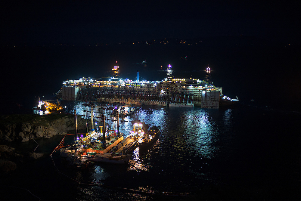 Costa Concordia is seen the night before the removal that will take the ship to the srap yard in Genoa