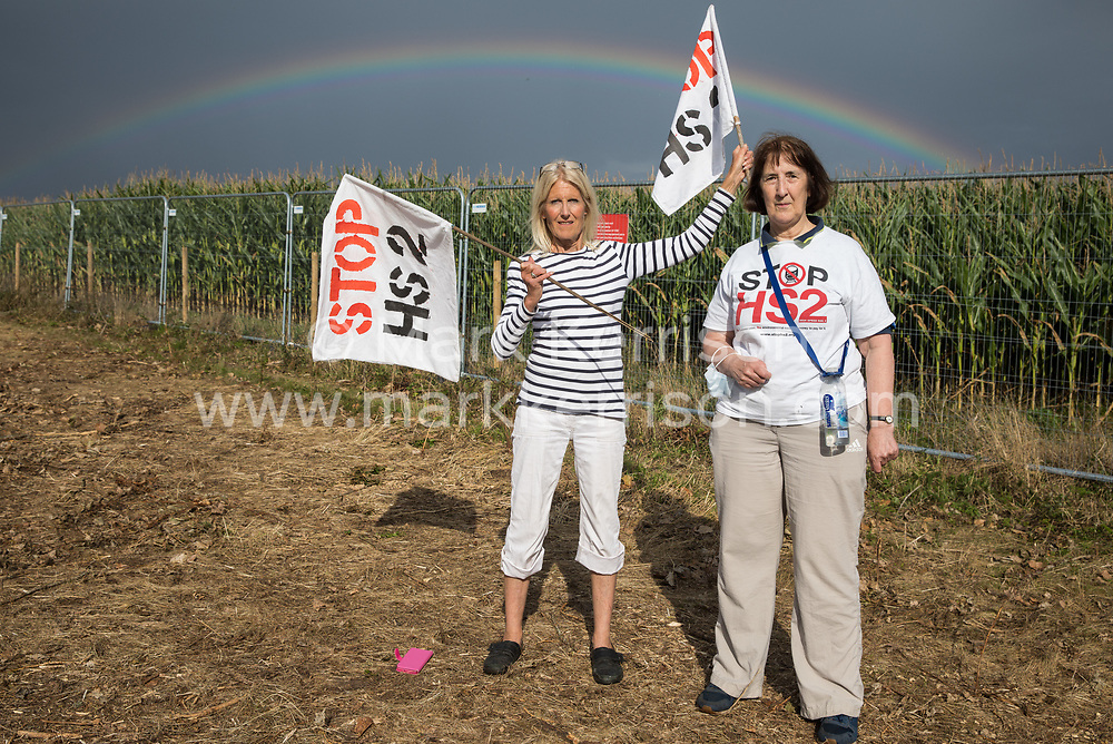 Anti-HS2 activists pose in front of a rainbow alongside the Fosse Way after attempting to protect a mature oak tree from felling in connection with the HS2 high-speed rail link on 24th August 2020 in Offchurch, United Kingdom. The controversial HS2 infrastructure project is currently expected to cost £106bn and will destroy or significantly impact many irreplaceable natural habitats, including 108 ancient woodlands.