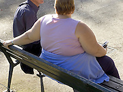 obese woman talking to a lean build man