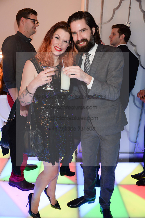FIFI TRIXIBELLE GELDOF and JACK GUINNESS at a party to celebrate 25 years of John Frieda held at Claridge's, Brook Street, London on 29th October 2013.