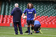 The Wales rugby team take part in public training session at the Millennium Stadium in Cardiff on Friday 29th Oct 2010. Adam Jones jokes with coach Warren Gatland