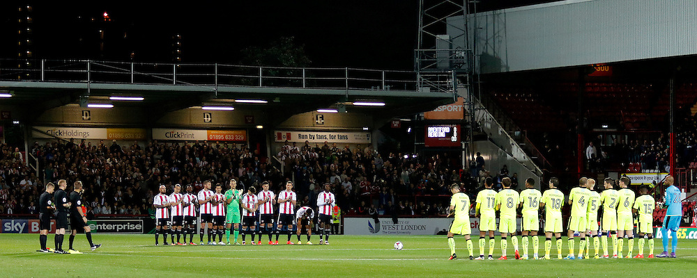 A minute's applause is observed for the late Tony Ashley of Brentford FC during the Sky Bet Championship match between Brentford and Reading at Griffin Park in London. September 27, 2016.<br /> Carlton Myrie / Telephoto Images<br /> +44 7967 642437