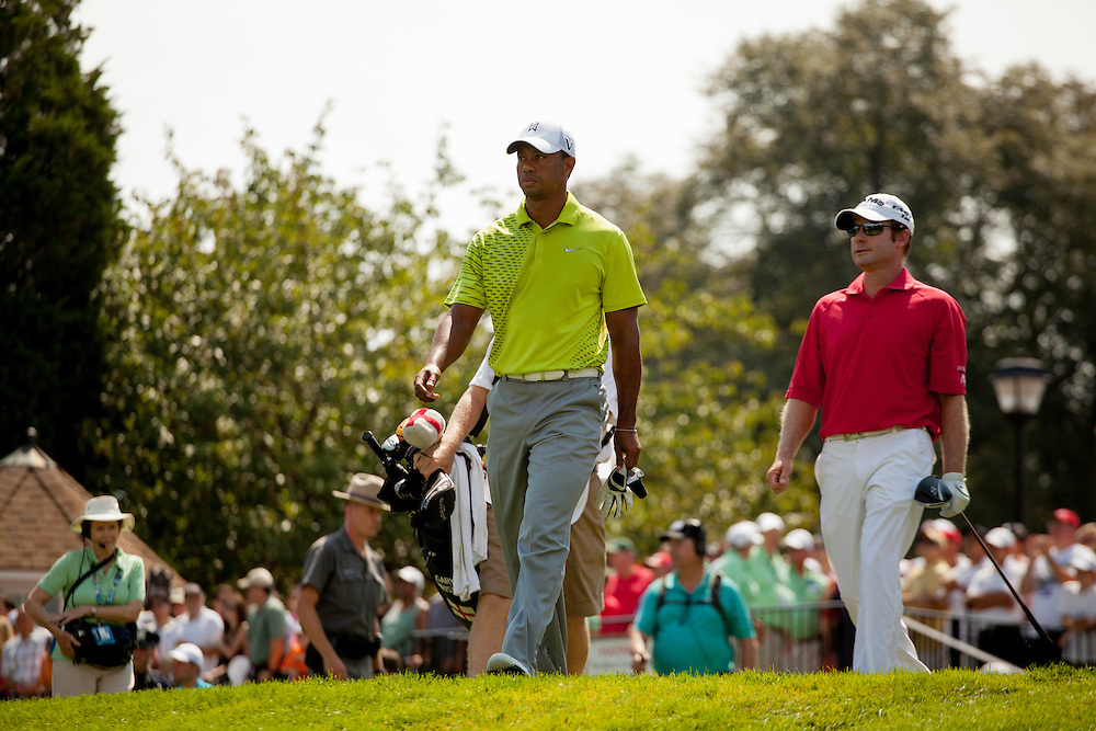 FARMINGDALE, NY - AUGUST 25:  Tiger Woods and Gary Christian of England walk from the first tee box plays a tee shot during the third round of the 2012 Barclays at the Black Course at Bethpage State Park in Farmingale, New York on August 25, 2012. (Photograph ©2012 Darren Carroll) *** Local Caption *** Tiger Woods,Gary Christian