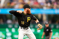 Jun 15, 2018; Pittsburgh, PA, USA; Pittsburgh Pirates third baseman Colin Moran (19) throws the ball to first base during the fourth inning against the Cincinnati Reds at PNC Park. Mandatory Credit: Ben Queen-USA TODAY Sports