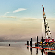 A different view of the Hudson River looking north west from Tarrytown, NY.  The tall crane creates a wonderful contrast to the pastels on the quiet river.