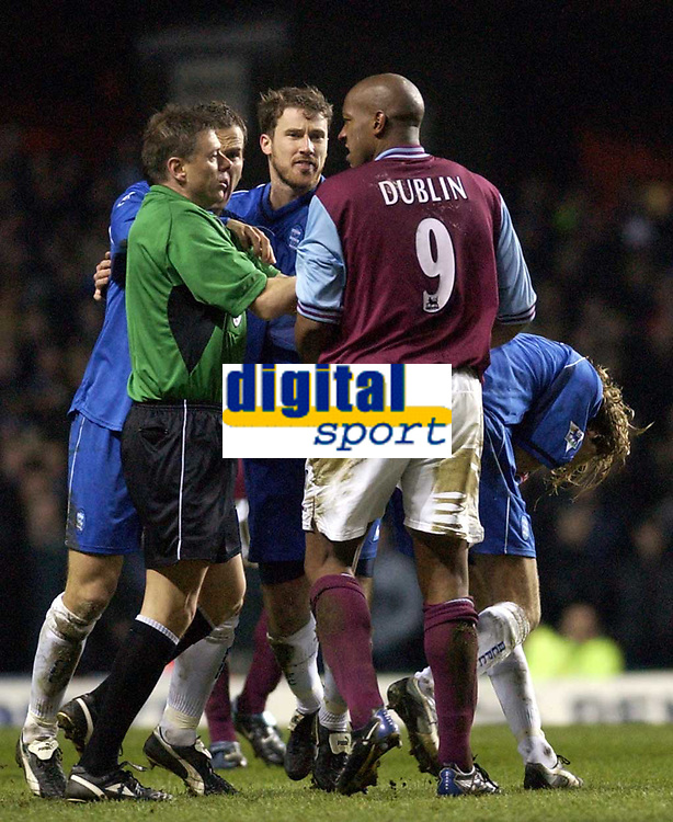 Copyright Sportsbeat. 0208 3926656<br />Picture: Henry Browne<br />Date: 03/03/2003<br />Aston Villa v Birmingham City Barclaycard Premiership<br />Dion Dublin is in trouble after headbutting Robbie Savage
