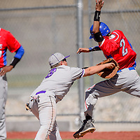 Miyamura Patriot Ozzie Guerrero (8) tags West Mesa Mustang Andrew Lucero (2) as leaps for first base Saturday at the Gallup Sports Complex.