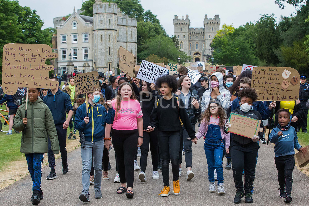 Hundreds of young people take part in a peaceful protest march in solidarity with the Black Lives Matter movement on 4th June 2020 in Windsor, United Kingdom. The march, along the Long Walk in front of Windsor Castle, was organised at short notice by Jessica Christie at the request of her daughter Yani, aged 12, following the death of George Floyd while in the custody of police officers in Minneapolis in the United States.