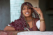Pretty young Indian woman at home in Narlai village in Rajasthan, Northern India