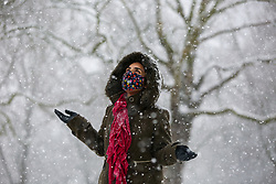 © Licensed to London News Pictures. 24/01/2021. London, UK. A woman braves the snow in Finsbury Park, north London as large parts of the UK are expected to be blanketed in snow and freezing conditions. According to the Met Office, the cold weather could bring up to 10cm of snow to some parts of the country and an amber weather warning for snow and ice is in place across much of the UK. Photo credit: Dinendra Haria/LNP