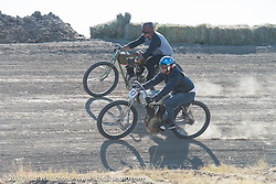 Billy Lane on his 1919 Harley-Davidson riding just above EBay Jake on 1919 Harley-Davidson racer in the Sons of Speed banked dirt oval racing at the Full Throttle Saloon during the annual Sturgis Black Hills Motorcycle Rally. Sturgis, SD. USA. Thursday August 10, 2017. Photography ©2017 Michael Lichter.