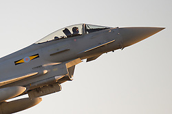 © Licensed to London News Pictures. 19/02/15. RAF Coningsby, UK. A Typhoon jet leaves RAF Coningsby on Wednesday 18th February 2015 at 16.30hrs with 11Squadron markings. Two RAF Typhoon fighters were scrambled on Wednesday, 18th February 2015, evening to escort Russian long range bombers flying off Cornwall, the Ministry of Defence has confirmed. The Typhoons were scrambled from RAF Coningsby in Lincolnshire. Photo credit : John Ellison/LNP