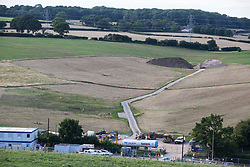 Chalfont St Giles, UK. 18th July, 2020. Earth is piled up close to the site of a ventilation shaft for the Chiltern Tunnel on the HS2 high-speed rail link. The Department for Transport approved the issuing of Notices to Proceed by HS2 Ltd to the four Main Works Civils Contractors (MWCC) working on the £106bn rail project in April 2020.