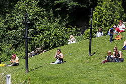 © Licensed to London News Pictures. 14/07/2021. Edinburgh, Scotland, UK. People enjoy a hot and sunny day in Edinburgh as warm weather continues in Scotland. According to the Met Office, a high of 23 degrees celsius is forecast for the rest of the week. Photo credit: Dinendra Haria/LNP