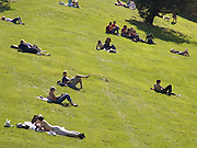 people lying on the grass in a park Paris France