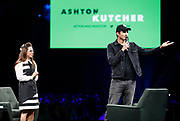 Actor and investor Ashton Kutcher, right, greets the crowd at Intuit's QuickBooks Connect 2019 on Thursday, Nov. 7, in San Jose, Calif. (Adm Golub/AP Images for Quickbooks)