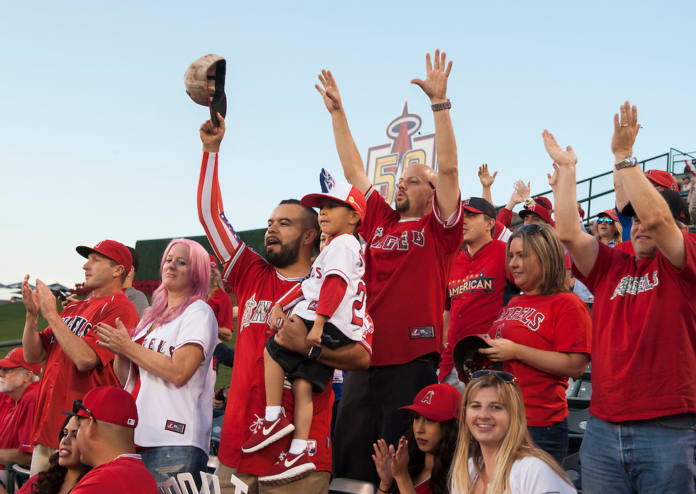 Jonathan Plaza and his son A.J., surrounded by fellow fans, take in the 2016 Angels home opener at Angel Stadium Monday.<br /> <br /> <br /> ///ADDITIONAL INFO:   <br /> <br /> angels.0405.kjs  ---  Photo by KEVIN SULLIVAN / Orange County Register  --  4/4/16<br /> <br /> The Los Angeles Angels take on the Chicago Cubs during their 2016 home opener Monday at Angel Stadium.<br /> <br /> <br />  4/4/16