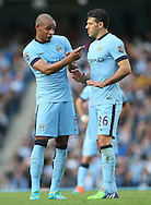 Fernando of Manchester City talks tactics to Martin Demichelis of Manchester City - Barclays Premier League - Manchester City vs Manchester Utd - Etihad Stadium - Manchester - England - 2nd November 2014  - Picture David Klein/Sportimage