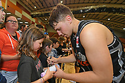 Taylor Hawks Hyrum Harris signs autographs for fans following the Sal's NBL Basketball match, Taylor Hawks v EnviroNZ Bulls, Pettigrew Green Arena, Napier, Saturday, June 26, 2021. Copyright photo: Kerry Marshall / www.photosport.nz