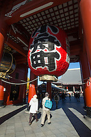 """Hozomon Gate or """"treasure house gate"""" the inner of two large entrances that lead to Sensoji Temple (the other being Kaminarimon).  Hozomon's second story houses many of the treasures of Sensoji and features three large lanterns. The largest red lantern is a red  hangs under the center of the gate opening.  displaying  the town Kobunacho name in Kanji, or Chinese characters."""