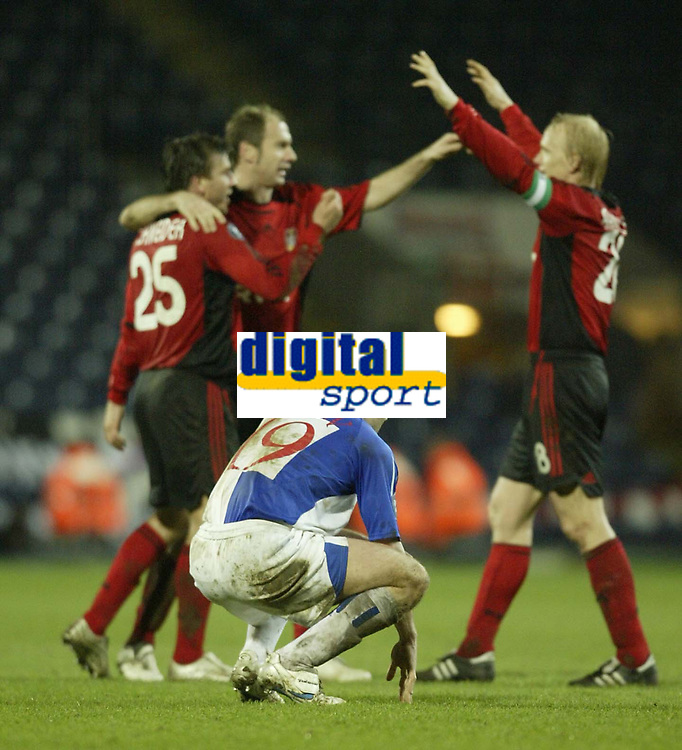 Photo: Aidan Ellis.<br /> Blackburn Rovers v Bayer Leverkusen. UEFA Cup, 2nd Leg. 22/02/2007.<br /> Rovers David Dunn is gutted at the final whistle as Bayer players celebrate going through to the next round