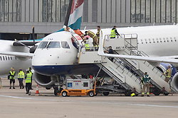 © Licensed to London News Pictures. 10/10/2019. London, UK. An Extinction Rebellion protester is removed from a British Airways Plane at London City Airport . Photo credit: George Cracknell Wright/LNP