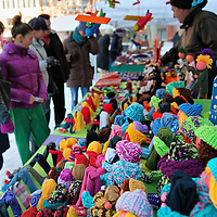 "VENICE, ITALY - DECEMBER 18:  Shoppers browse at a stall selling locally hand made dolls at ""l'Altro Natale"" Christmas market on December 18, 2010 in Venice, Italy. ""L'Altro Natale"" an alternative Christmas market organised over the busiest shopping week end of the year promotes fair trade and alternative commerce. (Photo by Marco Secchi/Getty Images)"