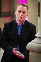 """© Licensed to London News Pictures . 14/10/2013 . Gorton Monastery , Manchester , UK . TERRY CHRISTIAN amongst the mourners . The Humanist funeral of photographer Harry Goodwin , attended by footballers and other celibrities and featuring music by artists he had photographed including """"He Ain't Heavy, He's My Brother"""" by the Hollies and """" Happiness """" by Ken Dodd . Photo credit : Joel Goodman/LNP"""