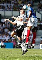 Photo: Steve Bond. <br />Derby County v Portsmouth. Barclays Premiership. 11/08/2007. Steve Howard (L) heads past Silvain Distin (R)