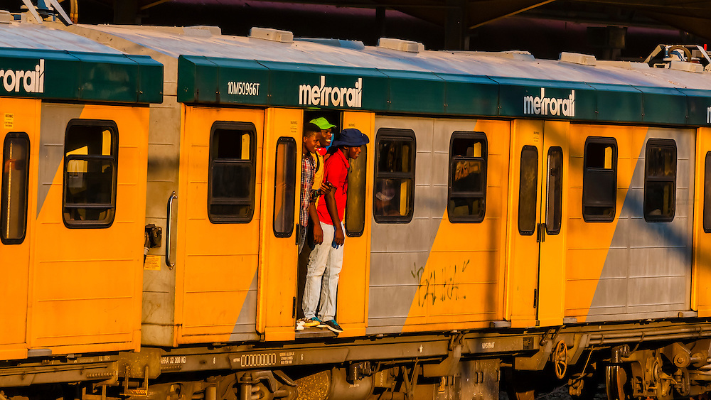 Commuters riding Metrorail train between Pretoria and Johannesburg, South Africa.