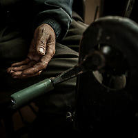 """""""Those rich Chinese in the eastern provinces, they pay lots of money for our coal but they have no idea about the price we pay. Our bitterness is their happiness,"""" says Liao Jianguo. Liao is paralyzed from the waist down. A detail of the hand crank Liao Jianguo uses to propel his wheelchair."""