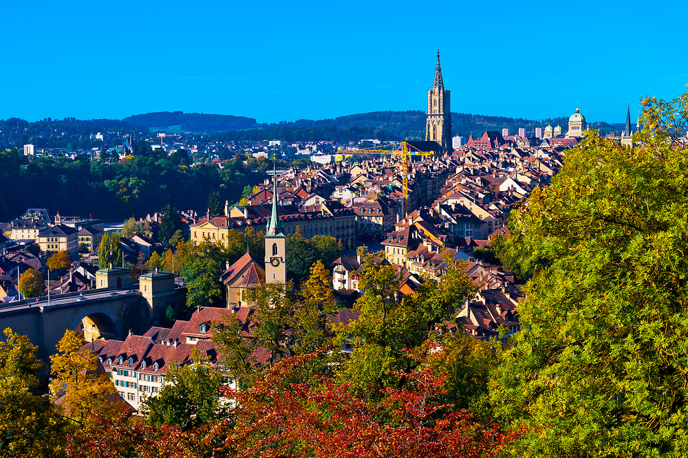 Cityscape of the medieval city center of Bern with the  Munster (Cathedral of Bern) and the Parliament Building (Federal Palace of Switzerland) in back, Bern, Canton Bern, Switzerland