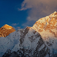 A sunset glows on Mount Everest and Nuptse in the Khumbu region of Nepal's Himalaya.
