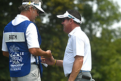 August 10, 2018 - St. Louis, Missouri, U.S. - ST. LOUIS, MO - AUGUST 10: Rich Beem celebrates with his caddie after hitting a birdie shot from the rough on the  #1 green  during the second round of the PGA Championship on August 10, 2018, at Bellerive Country Club, St. Louis, MO.  (Photo by Keith Gillett/Icon Sportswire) (Credit Image: © Keith Gillett/Icon SMI via ZUMA Press)
