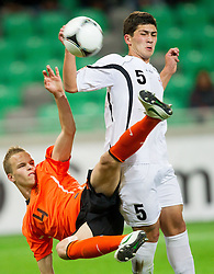 Jorrit Hendrix of Netherlands vs Giga Samkharadze of Georgia during the UEFA European Under-17 Championship Semifinal match between Netherlands and Georgia on May 13, 2012 in SRC Stozice, Ljubljana, Slovenia. Netherlands defeated Georgia 2-0. (Photo by Vid Ponikvar / Sportida.com)