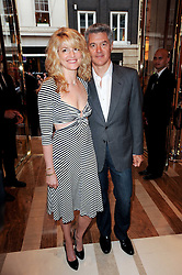 JOHN FRIEDA and his wife AVERY at a party to celebrate the opening of the Louis Vuitton Bond Street Maison, New Bond Street, London on 25th May 2010.