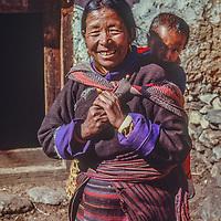 A Sherpa woman carries her grandson inPangboche Village in the Khumbu region of Nepal's Himalaya.