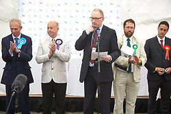 © Licensed to London News Pictures.  FILE PICTURE DATED 08/05/2015. Aylesbury, UK. Former Labour Parliamentary Candidate Will Cass (far right) reacts as the result of the Aylesbury count is announced following the 2015 general election. He has criticised the repatriation of the 30 British victim of the Tunisia terror attack on his personal Facebook page writing the victims 'should not be repatriated as if they were fallen soldiers. They weren't. They died on holiday not in service. Sad as it is, all this militarization makes it look as if the country is at war. It will legitimise a response (like bombing Syria). They will be used to justify an imperialist response.'<br /> <br /> Also in this picture: Minister for Europe and Conservative MP David Lidington (far left) and UKIP candidate Chris Adams (2nd left)<br /> <br />  Photo credit: Cliff Hide/LNP