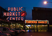 Pike Street Public Market Center, and Farmers Market neon signs, in downtown Seattle, Washington, USA.